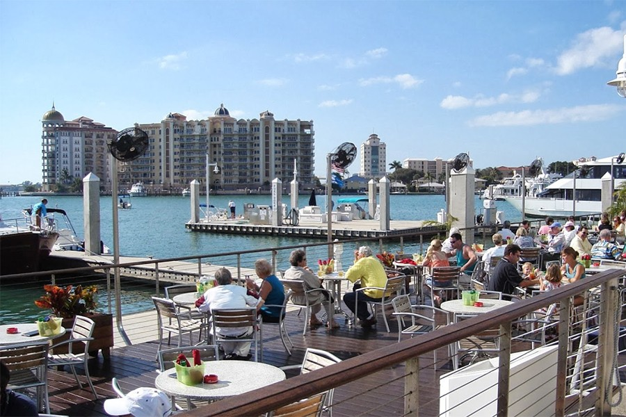 Relax And Unwind To The Ocean Breezes From The Gulf Of Mexico. Open Daily  Starting At 11:15AM The Recently Renovated Blue Sunshine Patio Bar U0026 Grill  ...