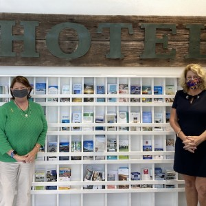 The DeMarcay Team Donates Historical Hotel Sign to Visit Sarasota County