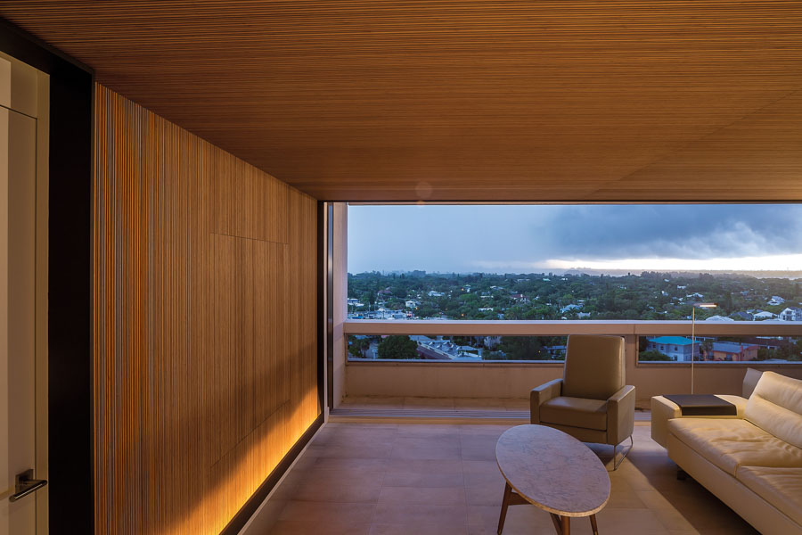 The TV Is Concealed Behind Large, Pivoting Wood Panels, Flush With The Plywood  Wall Finish.