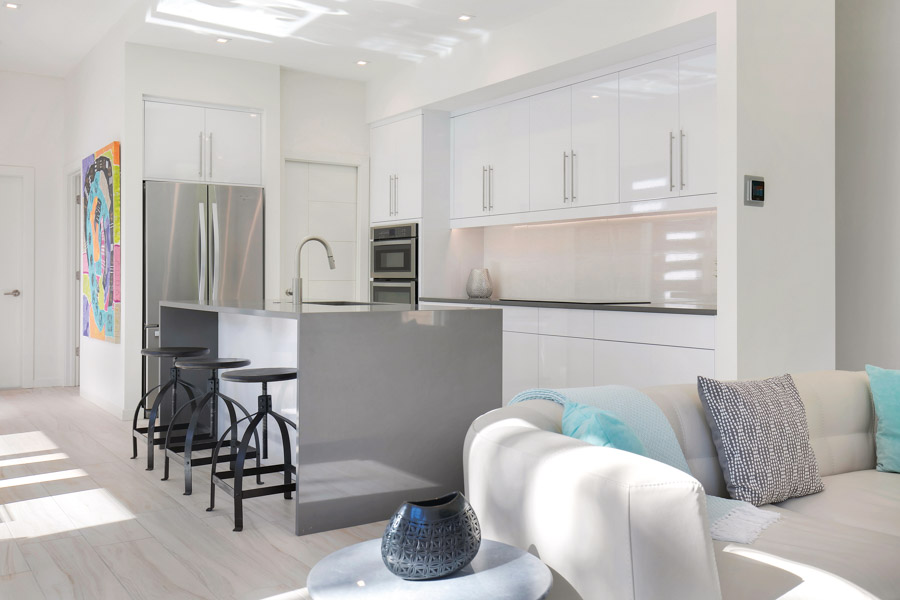 Clean lines and modern finishes continue into the interior living spaces and kitchen area.