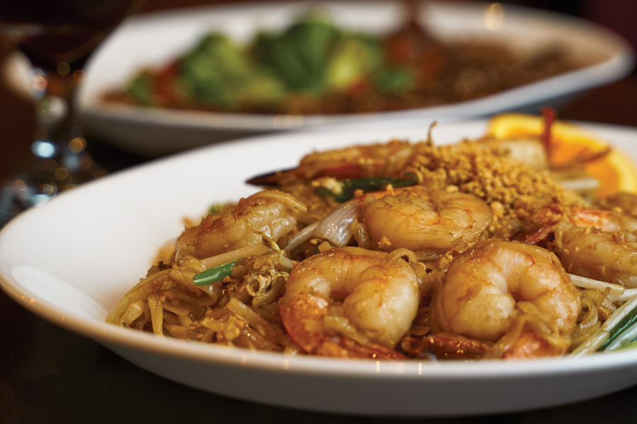 Enjoy a homemade classic with Siam Gulf's Shrimp Pad Thai, paired with Thai Tea. Photo by Wyatt Kostygan.