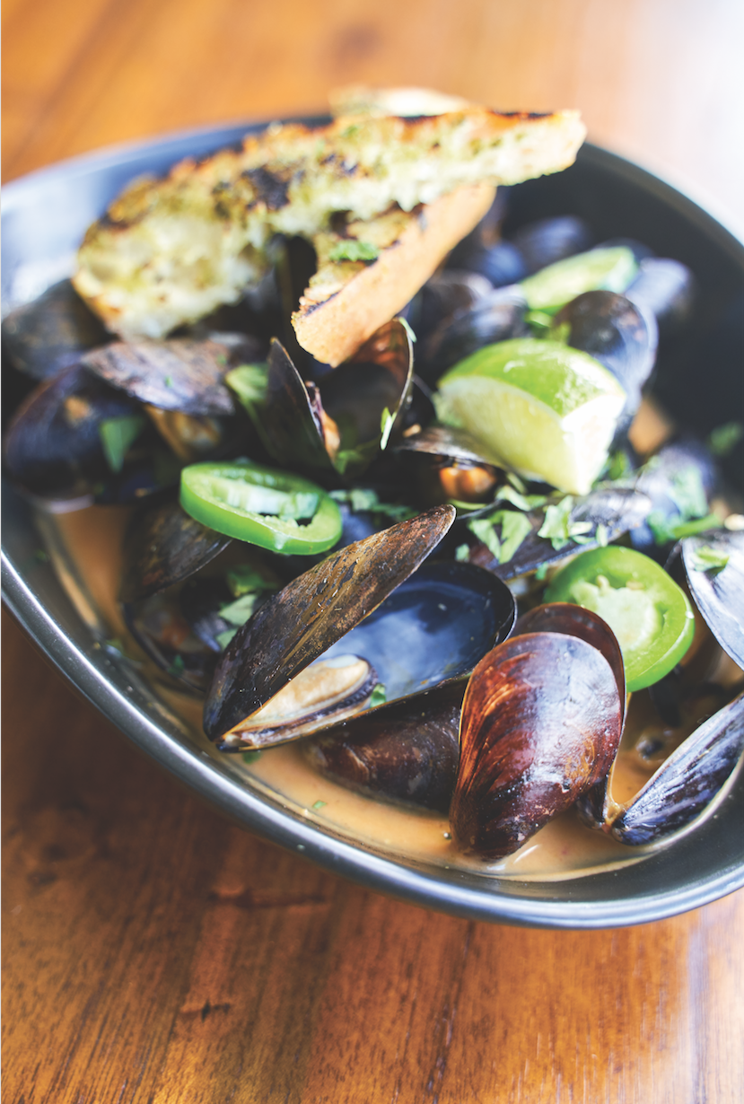 Thai curry mussels with coconut milk, kaffir lime, chili and cilantro. Photography by Wyatt Kostygan.