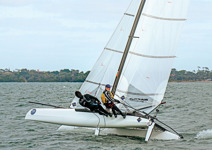 Award-winning sailor Jim Zellmer tames the mainsail of his Formula 18 Catamaran.