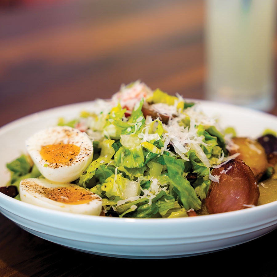 The Lyonnaise Salad will not leave you hungry. Photography by Wyatt Kostygan
