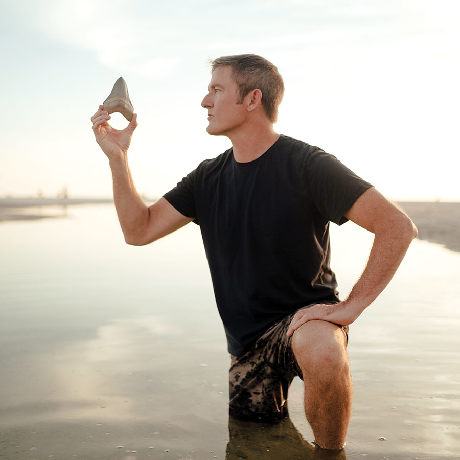 Zach Frignoca, professional shark tooth hunter and owner of Primitive Past, dives for fossilized shark teeth along the coast of Venice.