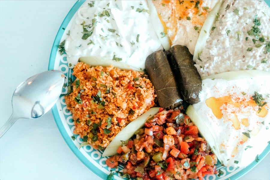 A mezze sampler offers guests a wide variety of Turkish appetizers, from smoky baba ganoush to ezme salad.